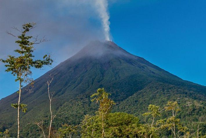 The smoking Arenal Volcano.