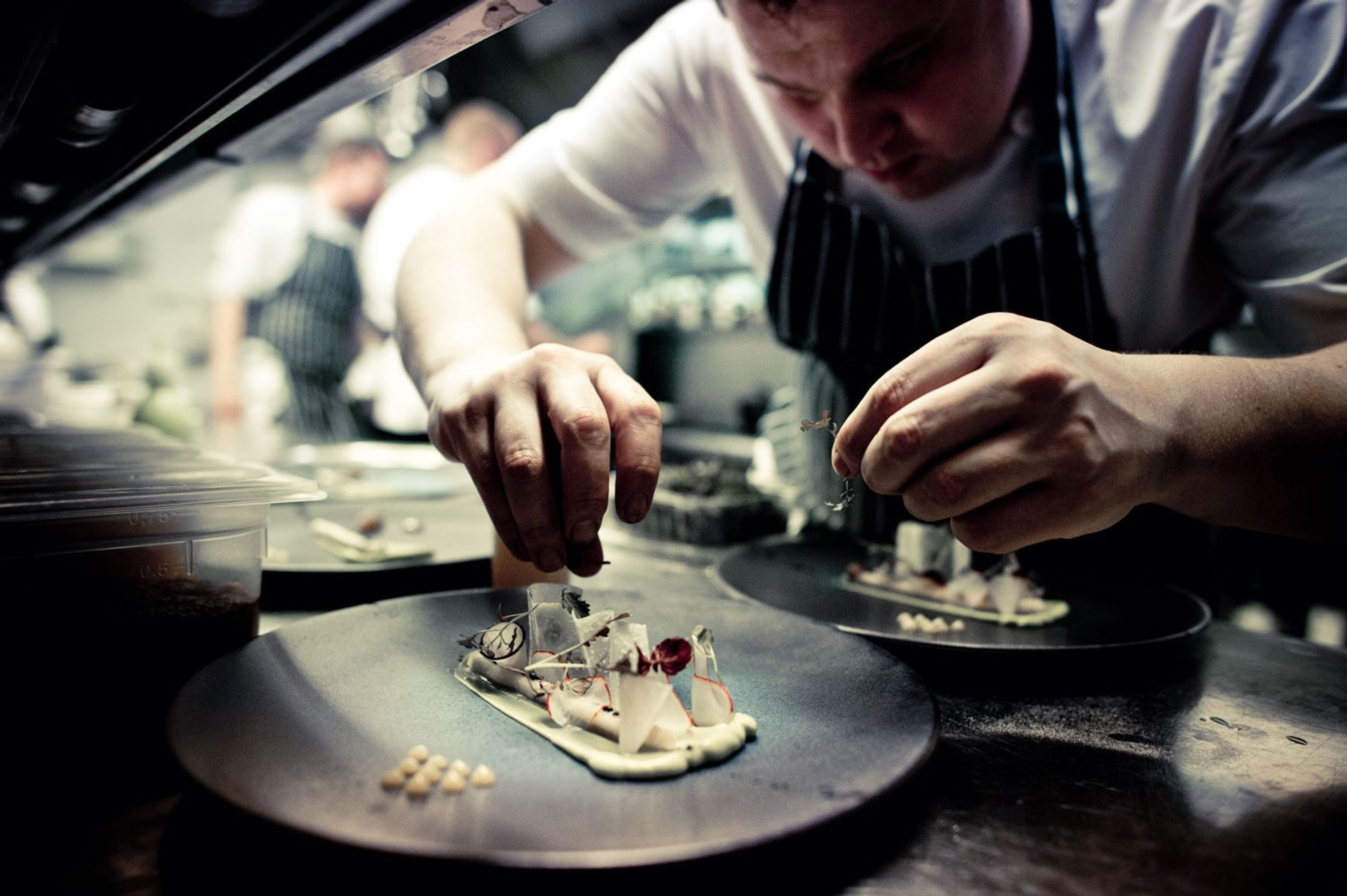 Chef plates up at The Greenhouse restaurant, Dublin