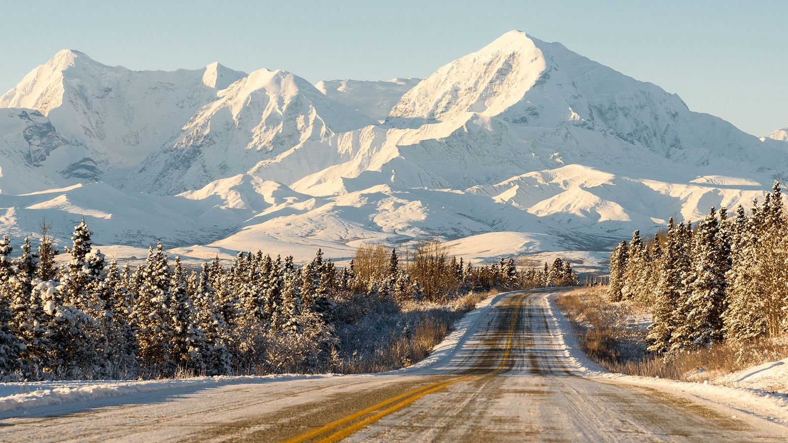 A remote mountain highway in Alaska during winter.