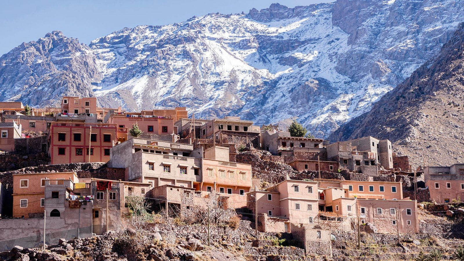 The Atlas mountains are jagged granite and limestone, reaching high into the bluest of African skies.
