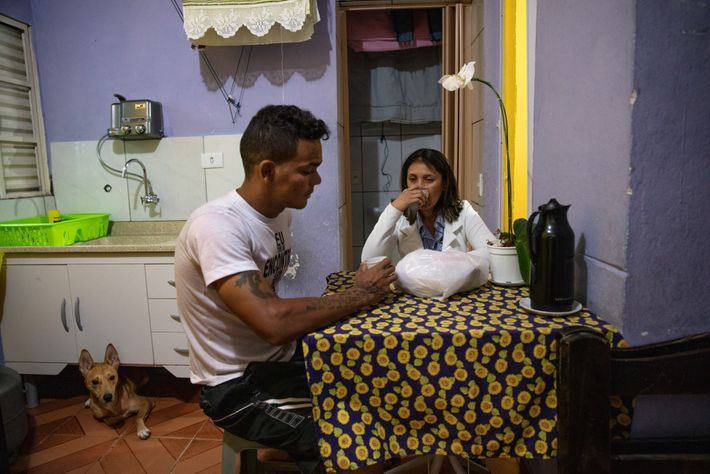 Almeida has breakfast with her husband Adriano Silva before she leaves for her job. One of ...
