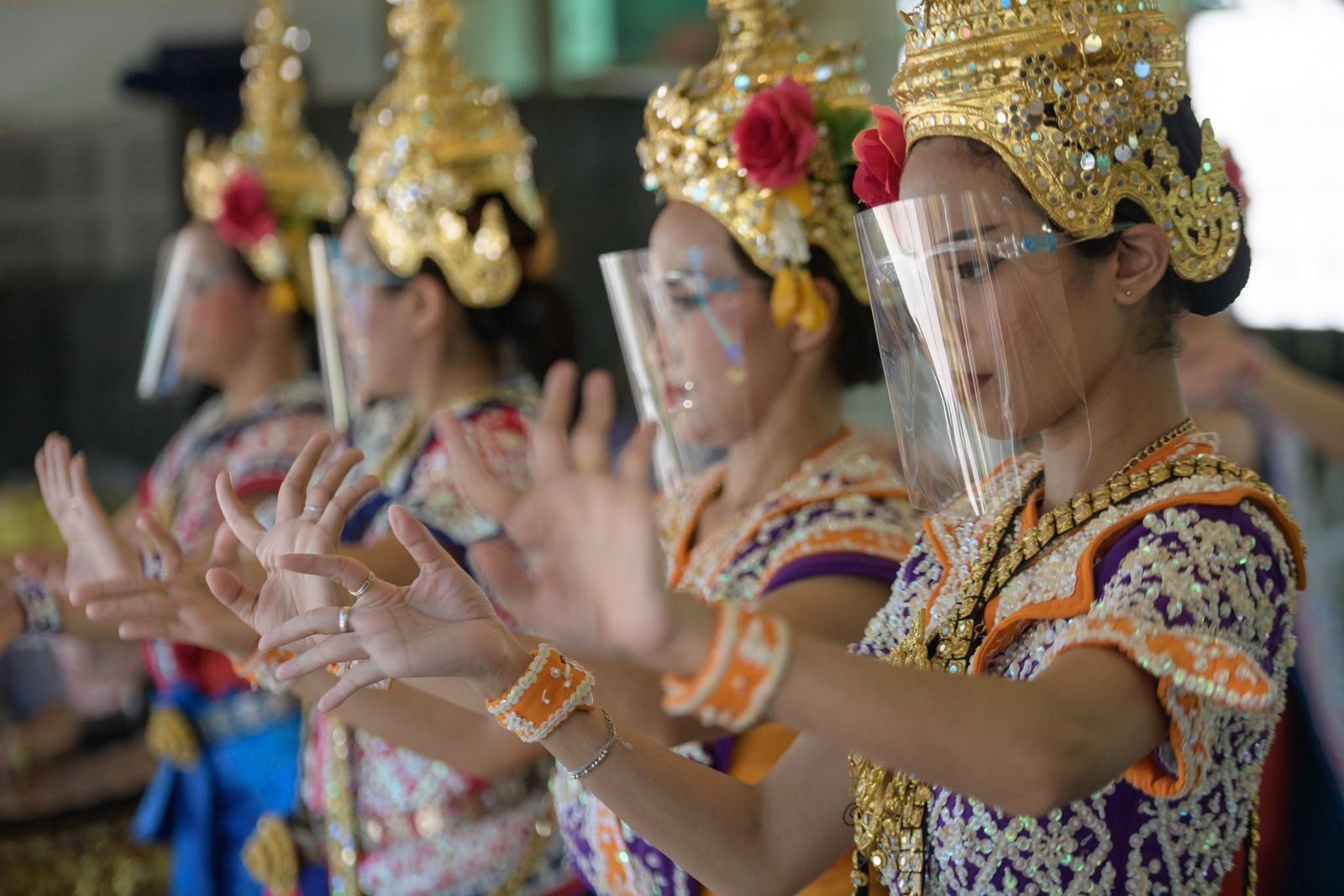 Thai traditional dancers at the Erawan Shrine in downtown Bangkok perform a ceremonial dance at the ...