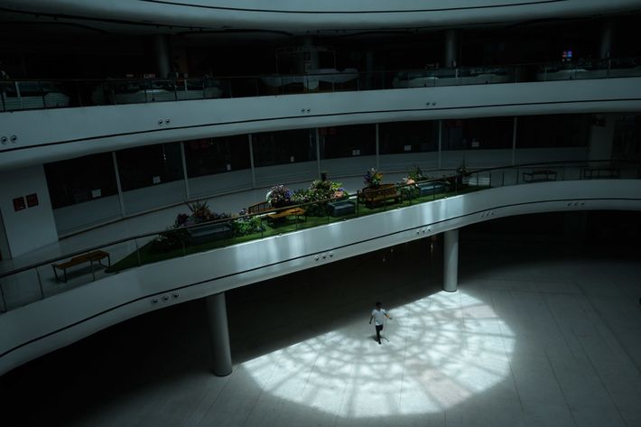 A man walks through the empty main hall of the Central Pinklao department store in Bangkok, ...