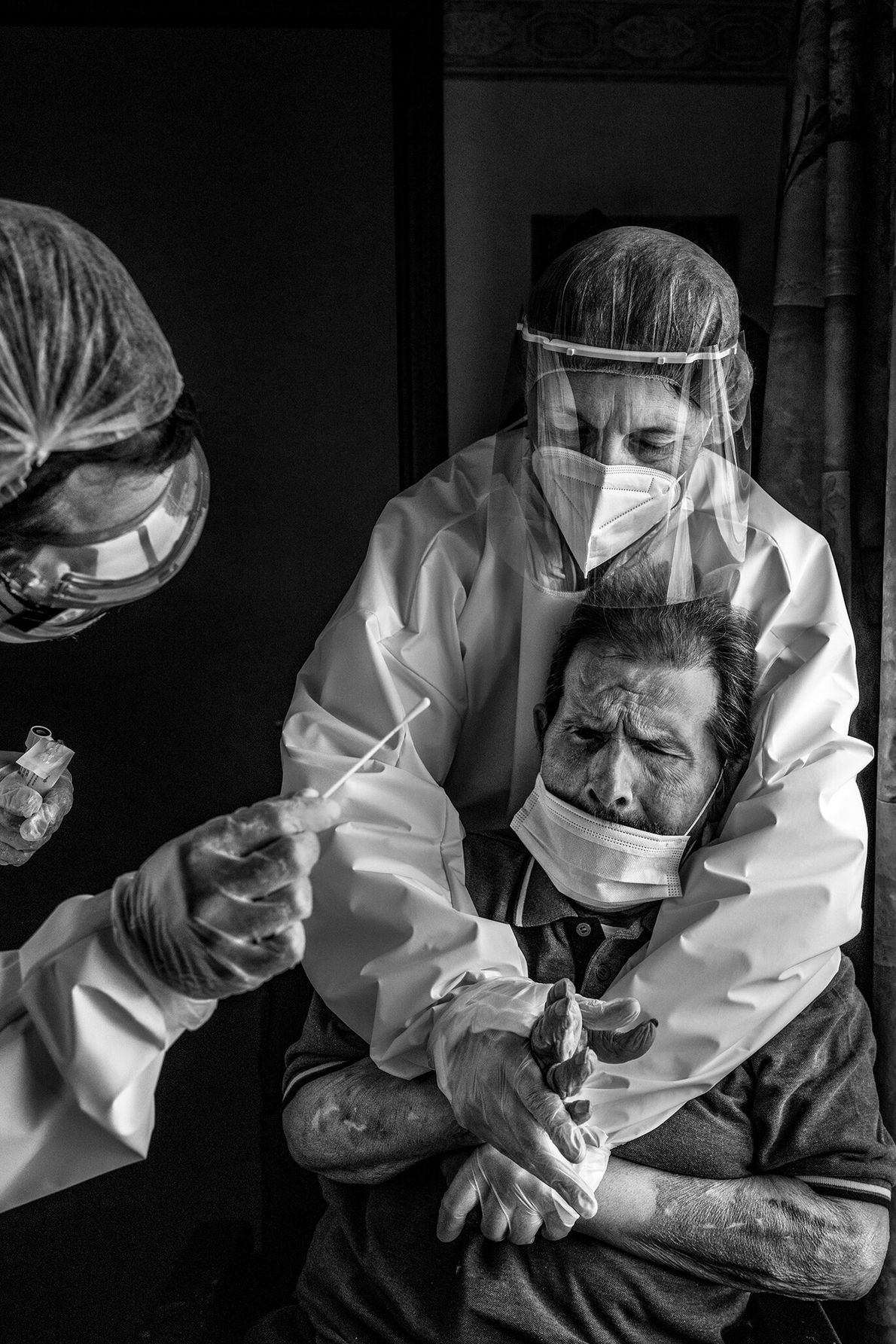 At a nursing home in La Louviere, Belgium, a nurse restrains and stabilizes a resident so ...