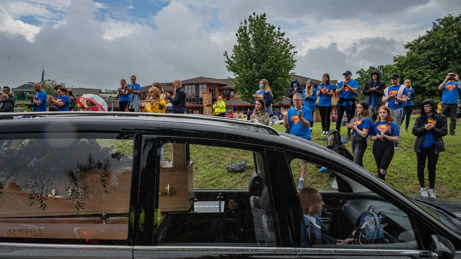 In June, the coffin of paramedic Peter James Hart passes in front of the East Surrey ...