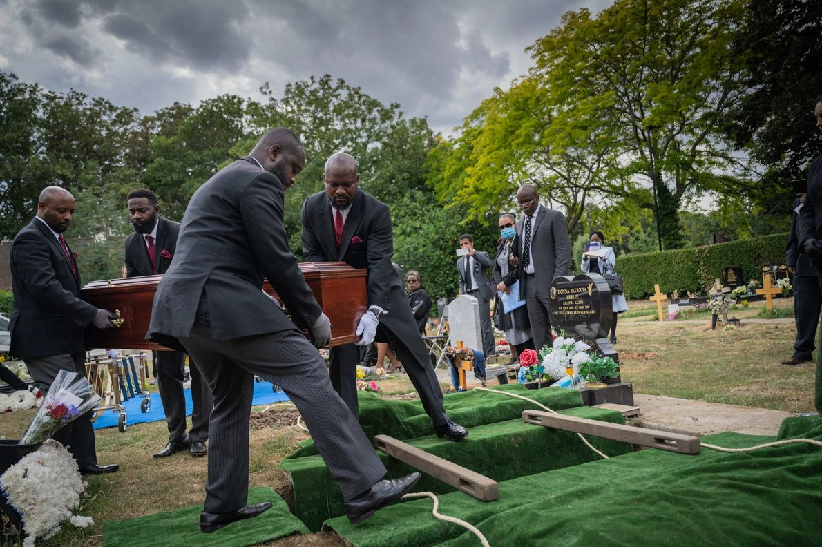 Relatives and loved ones gather for the double funeral of a 104-year-old mother and her son. ...