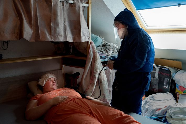 Dr. Spihlmann visits Roxane Kirschenmeyer, a patient with COVID-19, in her home. She has been suffering ...