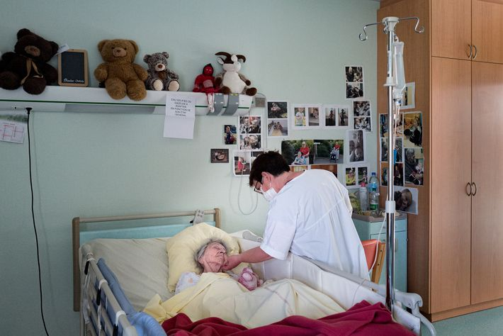 Dr. Spihlmann visits Lucie Pierré in her room at a nursing home. During the pandemic, all ...