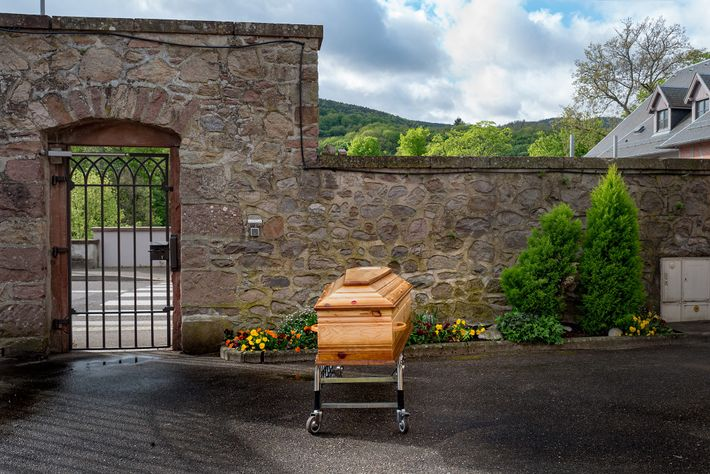 The coffin of a woman who died from COVID-19 awaits transport to the crematorium. She died ...