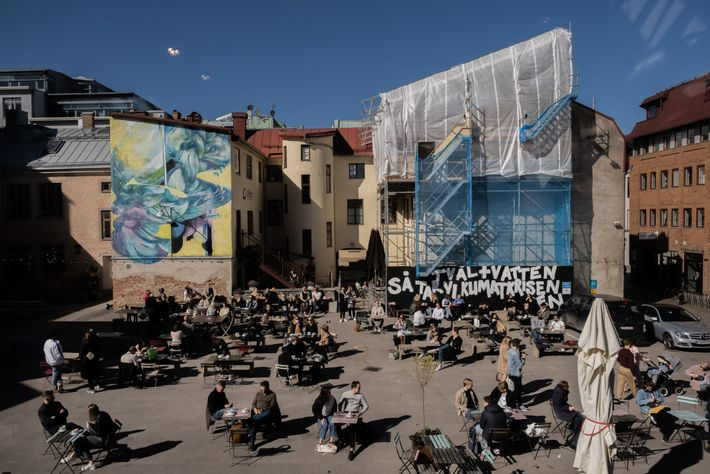 The Magasinsgatan shopping area, in Gothenburg, fills with people soaking up the long-awaited sun. Murals frame ...