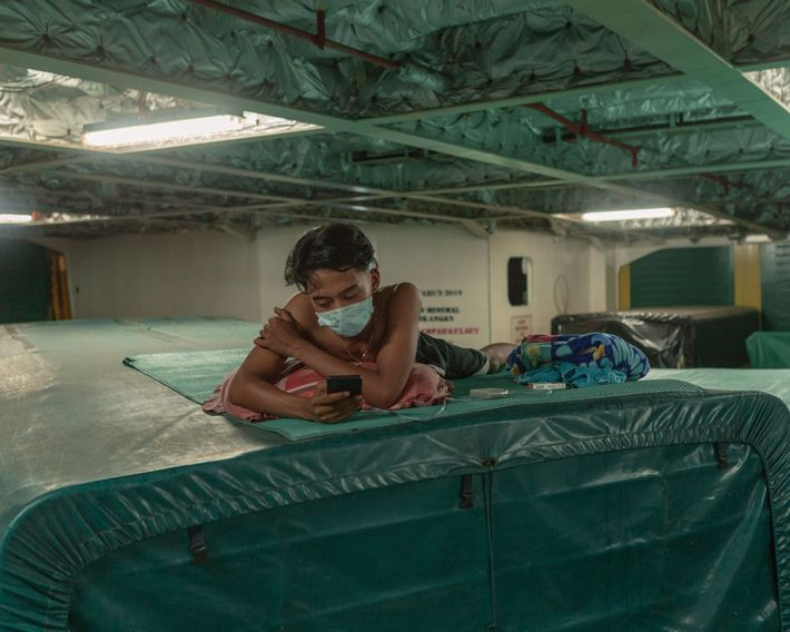 Truck driver Ahmad Farhan uses the downtime of a ferry crossing from Sumatra to Java to ...