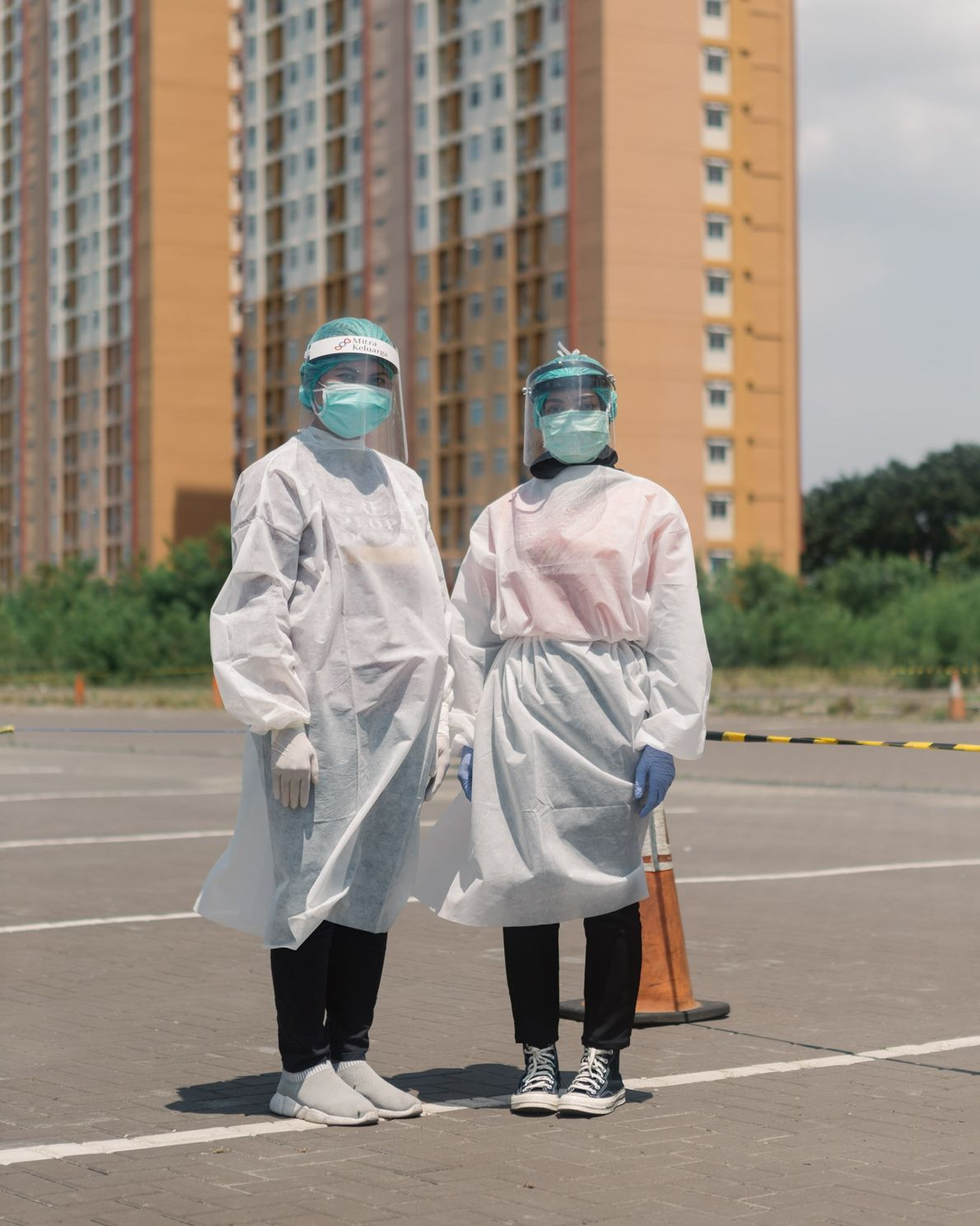 Two health workers at a drive-thru rapid testing site in Kemayoran, Jakarta, organised by a local ...