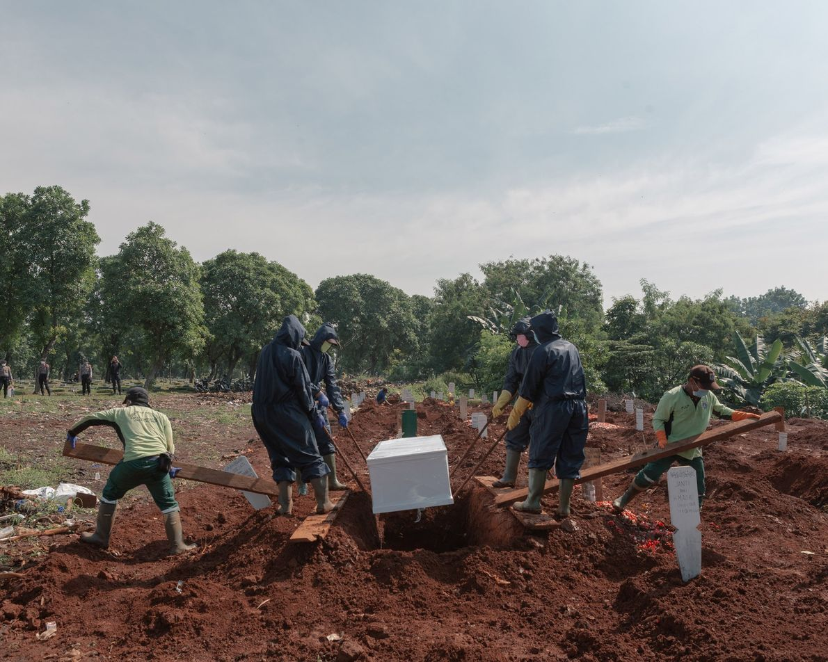 Workers bury a suspected COVID-19 victim in a burial ground reserved for pandemic casualties. Reuters reported ...