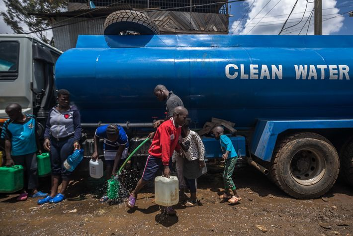 Kibera residents fill their jerry cans with free water distributed by the Kenyan government.