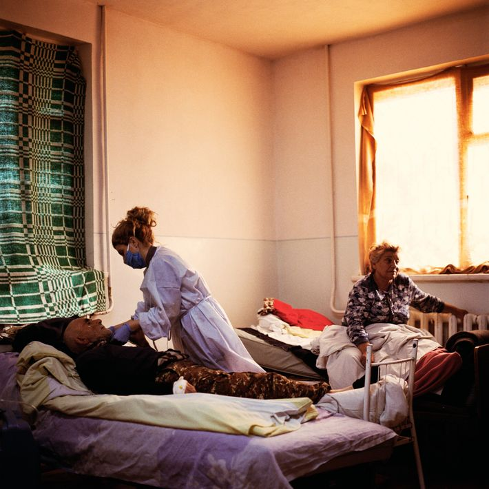 Nurse Gayane Mkrtchyan tends to Hrant Israelyan at the infectious disease hospital in Stepanakert. He and ...