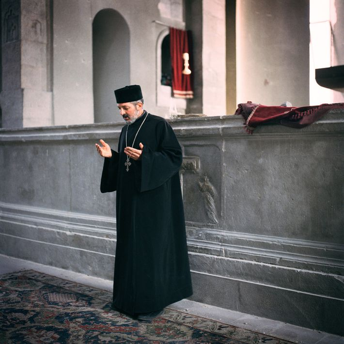 Father Andreas prays at Ghazanchetsots Cathedral in Şuşa, days before Azerbaijani forces seized the town.
