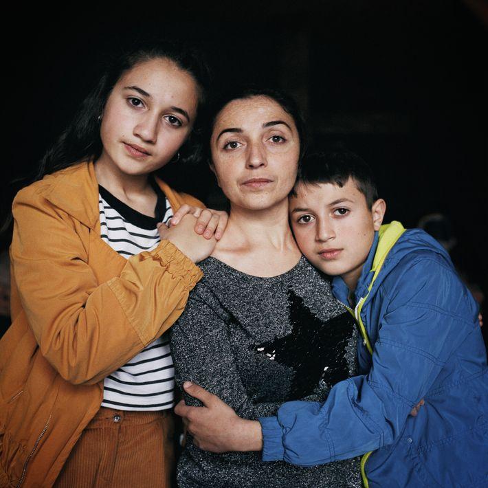 Arina Sarkisyan, a nurse, joined her children Mariam (left) and Narek in Tsagzhedor, Armenia, when Stepanakert ...