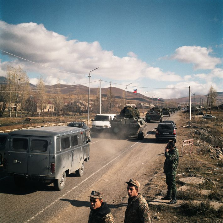 A Russian convoy passes an Armenian military checkpoint on the border between Armenia and Kalbajar district.