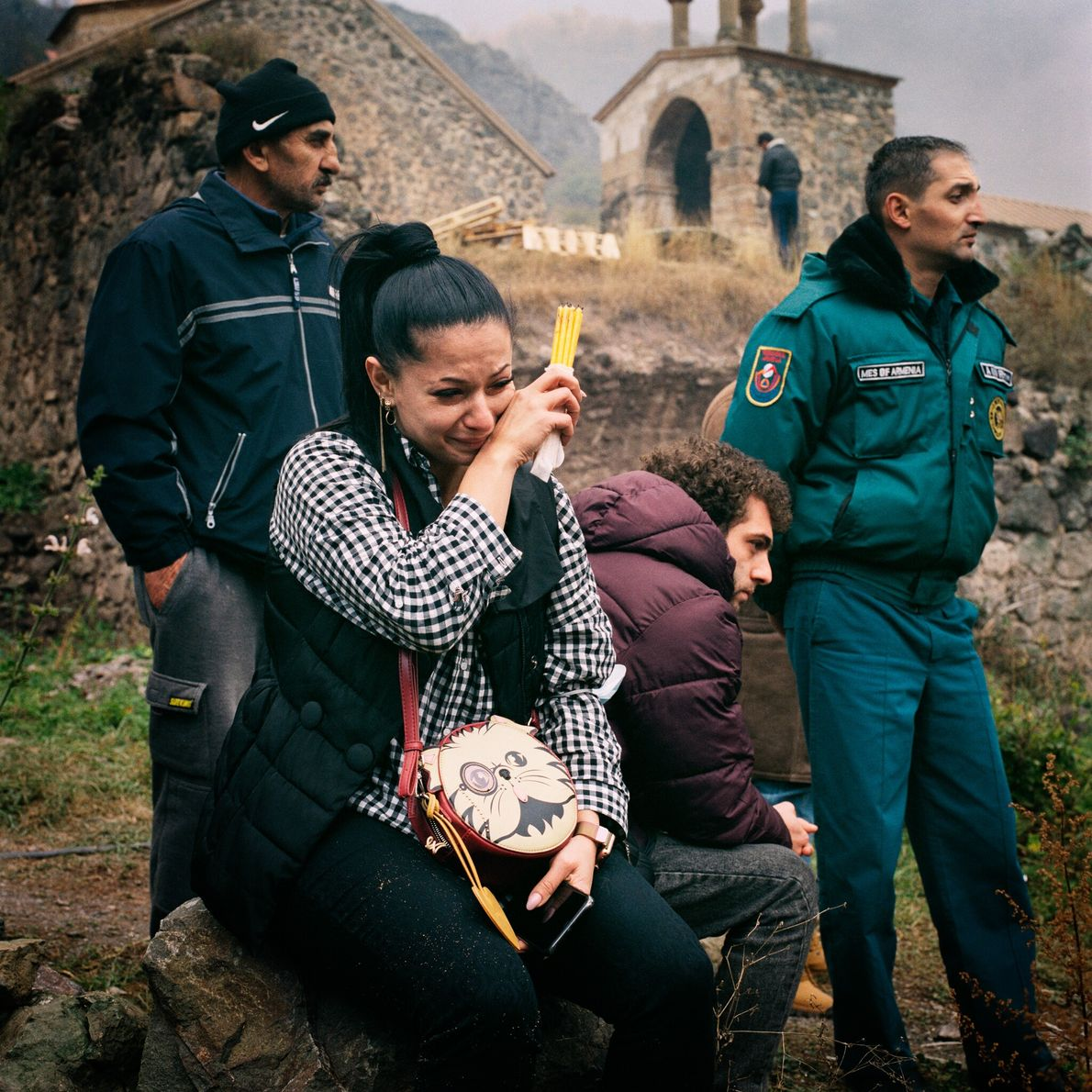 At the Dadivank Monastery in Kalbajar, Lilit Galstayan (left) cries as she watches a house burn ...