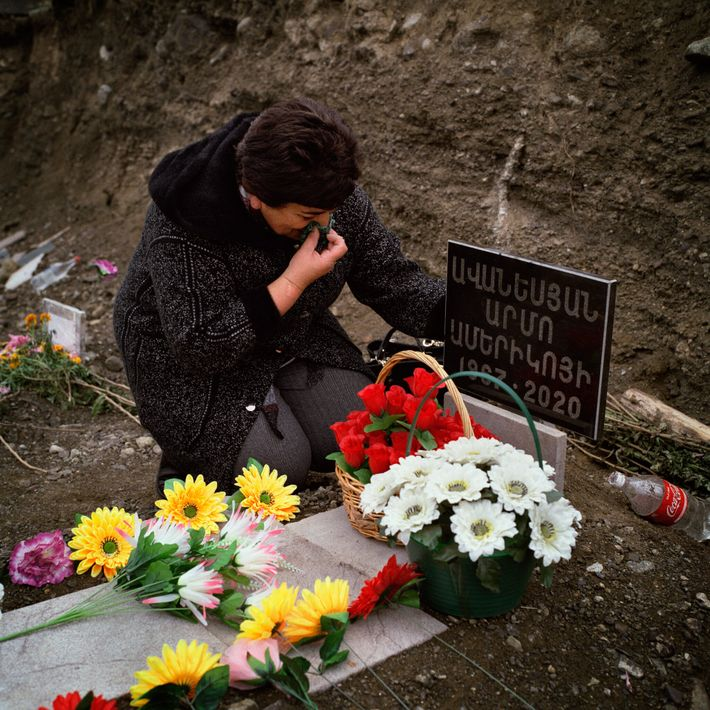 At the military cemetery in Stepanakert, Arevik Aranesyan mourns her husband, who was killed in action.