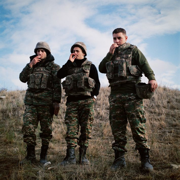 Near the village of Kramord, young Armenian soldiers Vrezh Tamamyan, Harutyun Petrosyan, and Gevorg Khachatryan hold ...