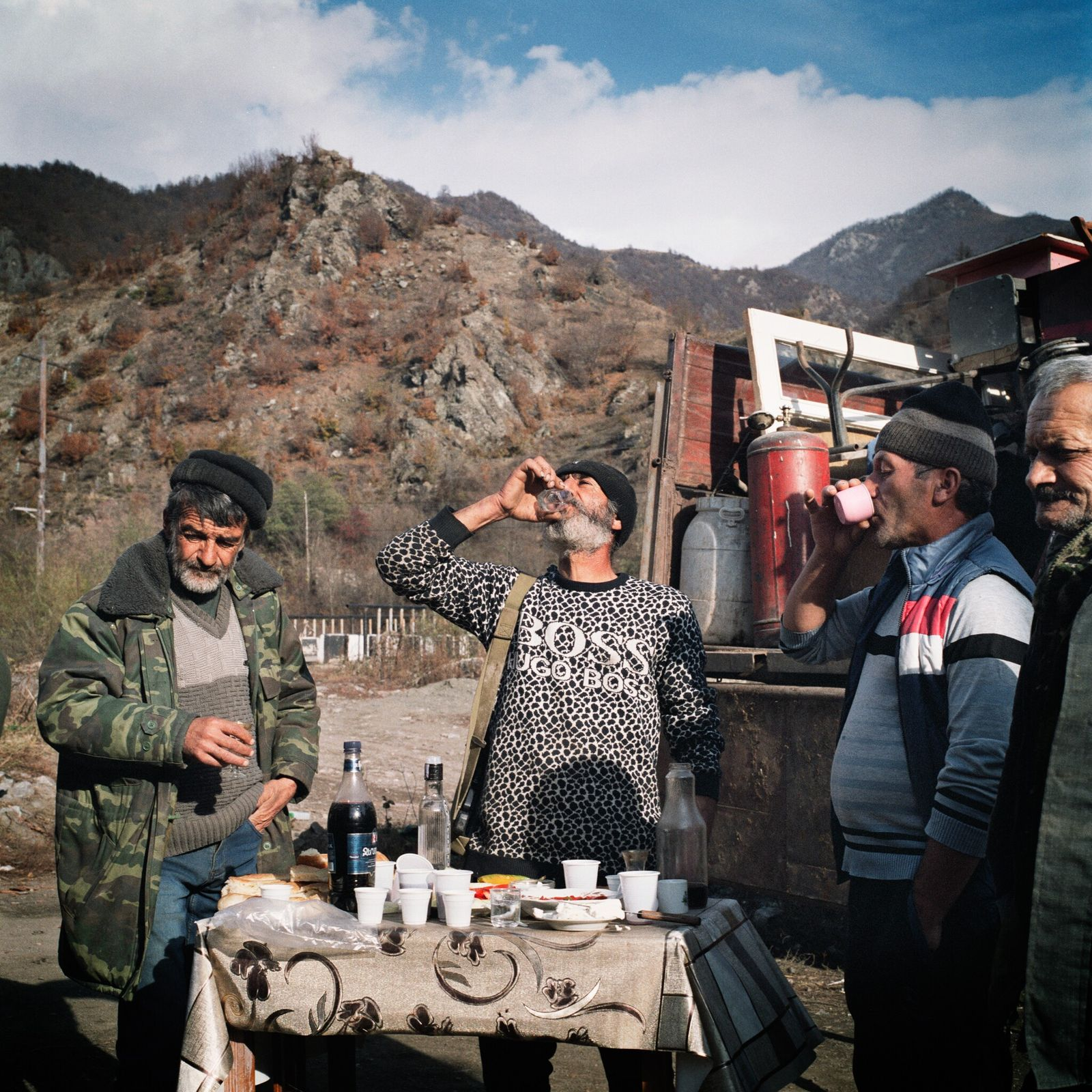 Volodya Grigoryan (right) shares one last lunch and vodka at his home before he and his ...