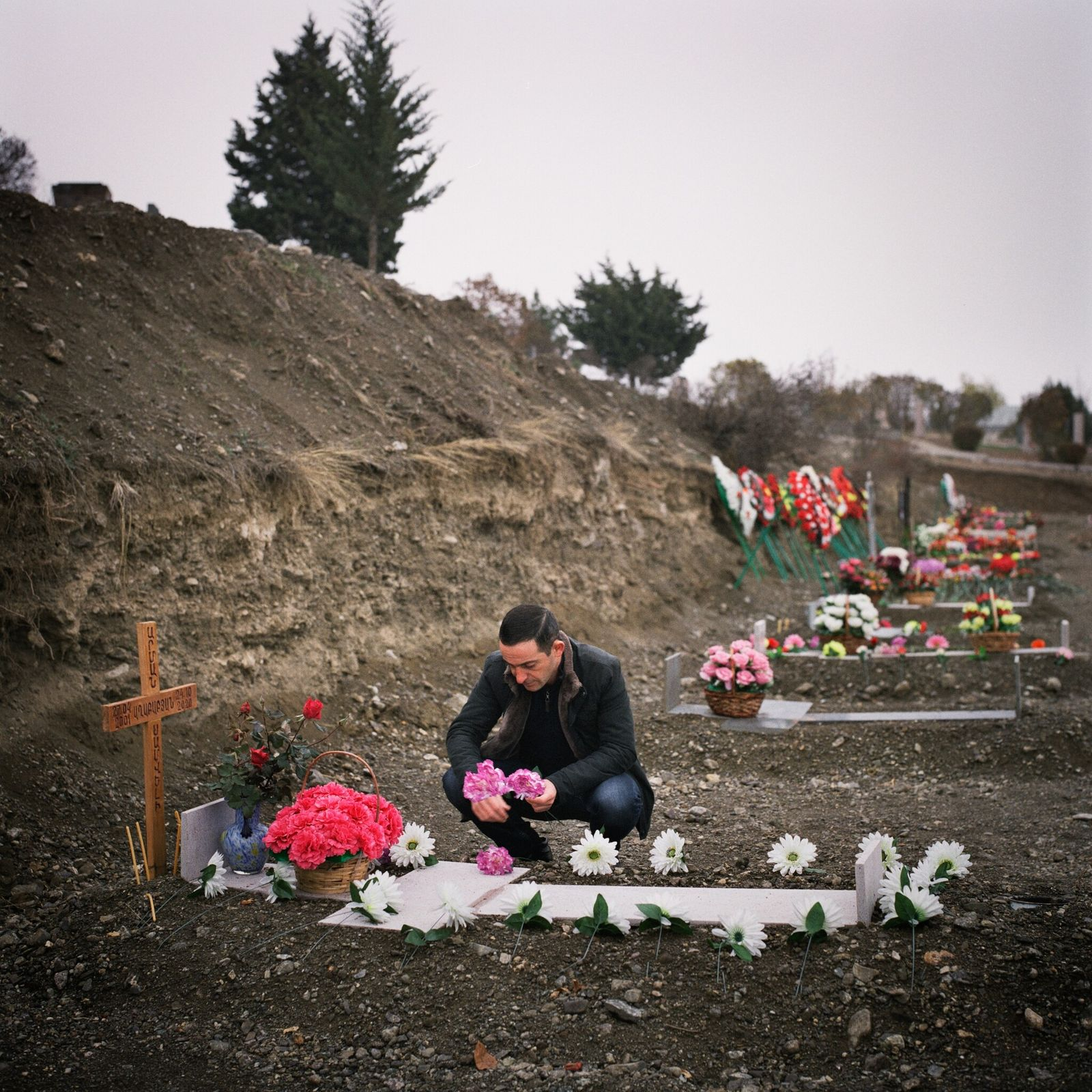 A man grieves at a military cemetery in Stepanakert, the capital of Nagorno-Karabakh. A six-week war ...