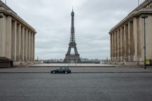 A lone police car enforces the lockdown on Place du Trocadero, across the River Seine from ...