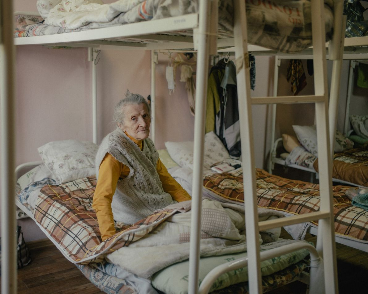 Claudia Ignatova, 80, surveys her new surroundings in a charity hostel on the outskirts of Moscow. ...