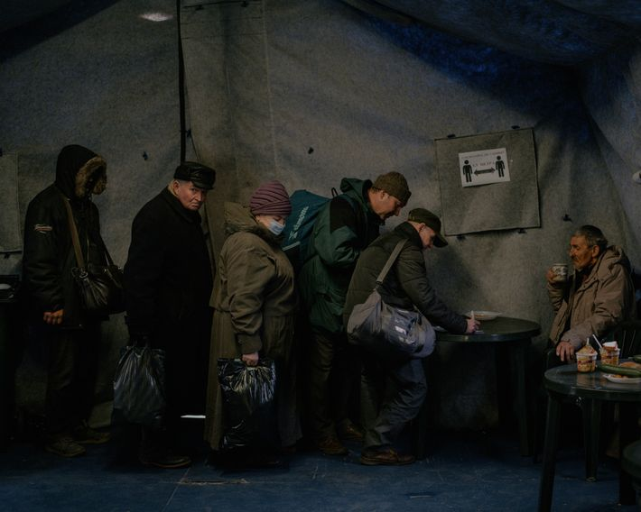 Inside a tented meal kitchen set up by an Orthodox church charity, homeless and other needy ...