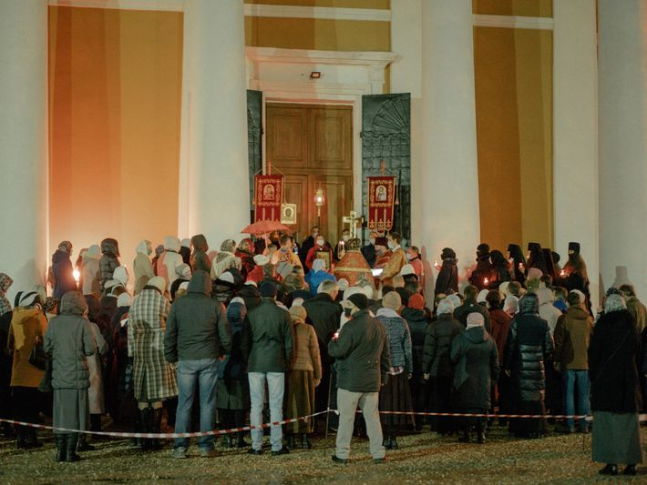 Faithful, masked, and un-distanced, Orthodox worshippers gather for procession and prayer outside a church in Tver, ...