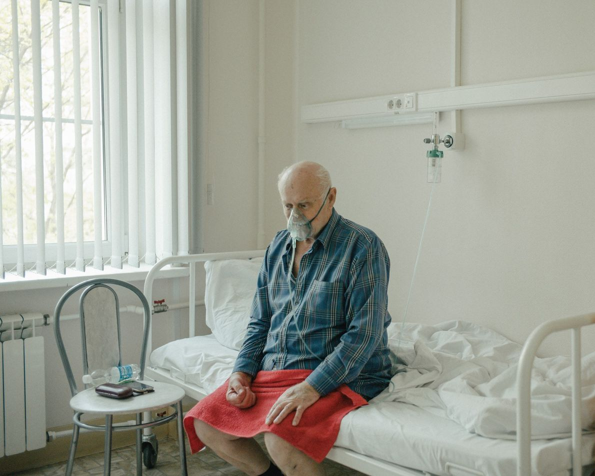 Inside Moscow's Hospital No. 52, a patient recovering from COVID-19 breathes in the oxygen that is ...