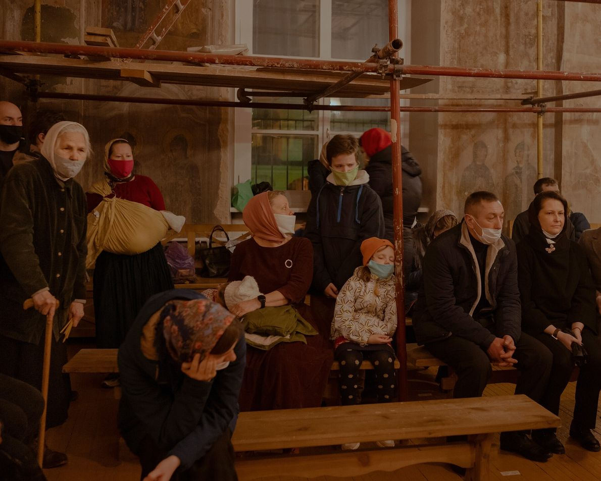 The coronavirus pandemic pushed people to adapt how they practice rituals. In Tver, Russia, mask-wearing worshippers ...