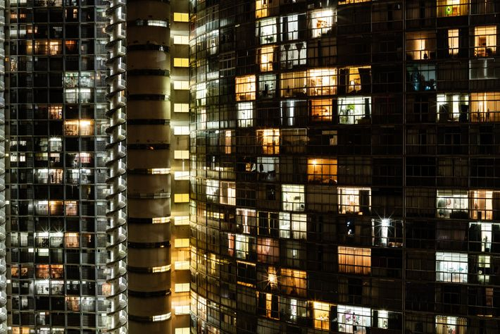 The Copan building glows in the centre of São Paulo as the city around it battles ...
