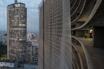 Downtown São Paulo at dusk, as seen from the edge of the Copan building. The city ...