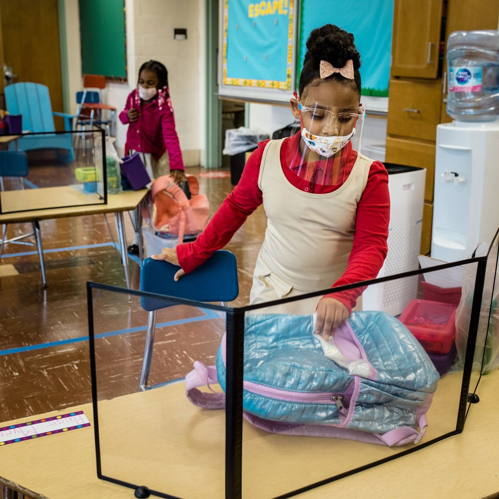 Students take their seats for the first day of in-person kindergarten at Walter P. Carter Elementary/Middle ...