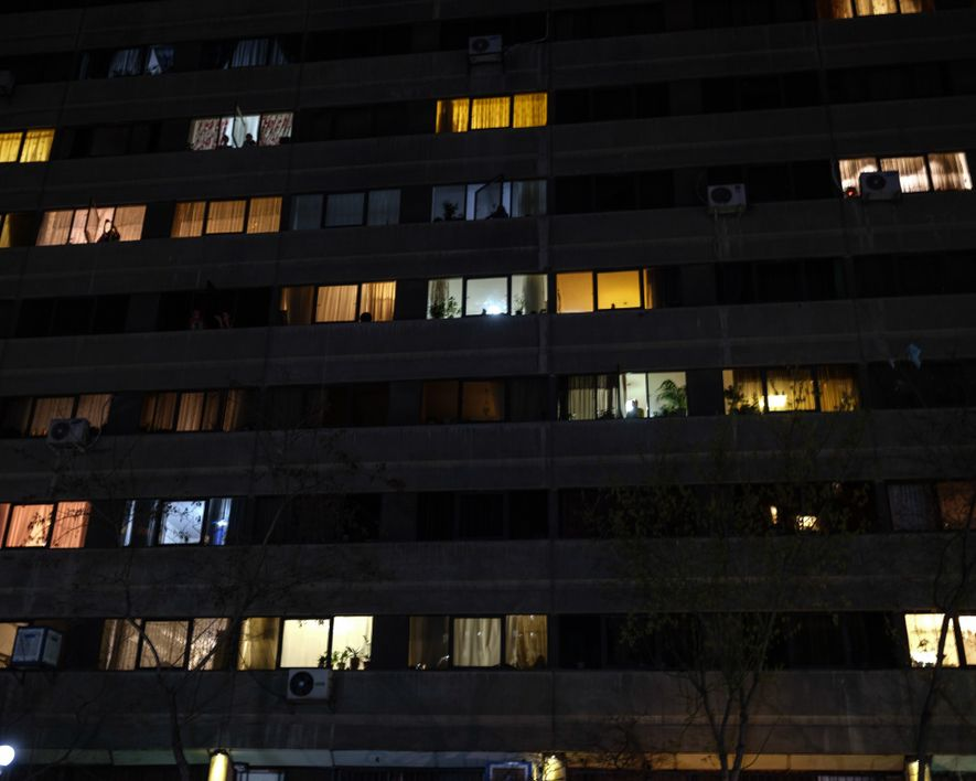 "In the ""Ekbatan"" apartment complex in west Tehran, inhabitants come to their windows at 8 p.m. ..."