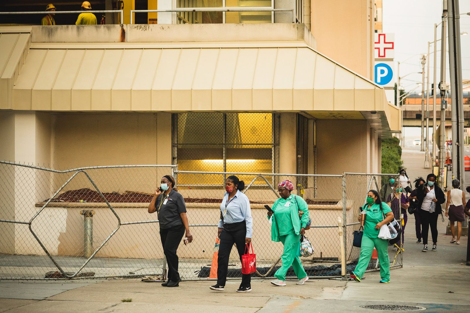 Healthcare workers arrive for their shift at Grady Memorial Hospital in Atlanta, Georgia, where COVID-19 cases ...