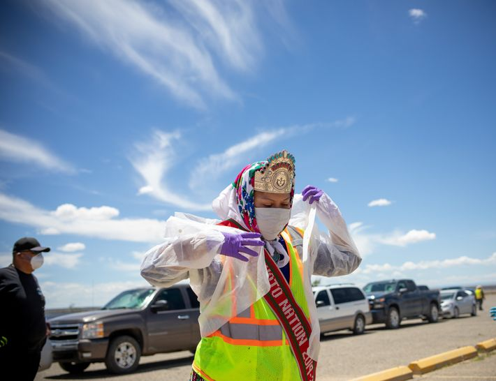 Shaandiin Parrish, the current Miss Navajo Nation, prepares to distribute food, water, and other supplies in ...