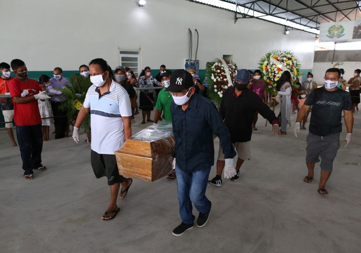 Mourners carry the coffin at the funeral of Chief Messias, 53, of the Kokama tribe, who ...