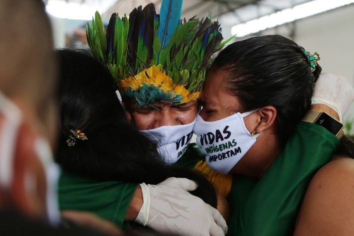 At a funeral service held at the Park of Indigenous Nations, in Manaus, relatives mourn the ...