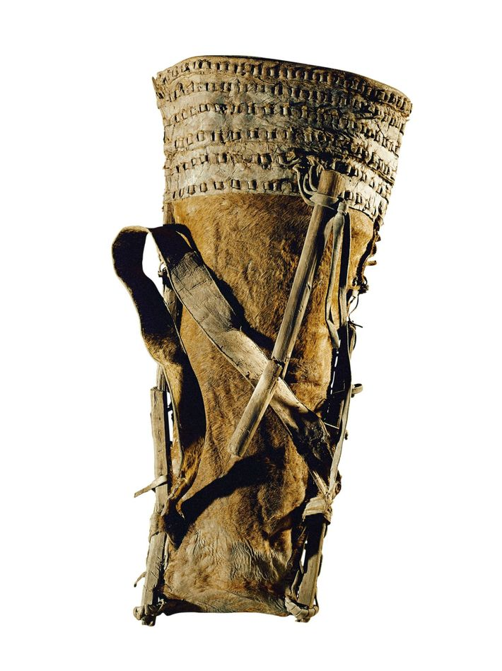 Made from cowhide and wood, this hod- style bag dates to the tenth or ninth century ...