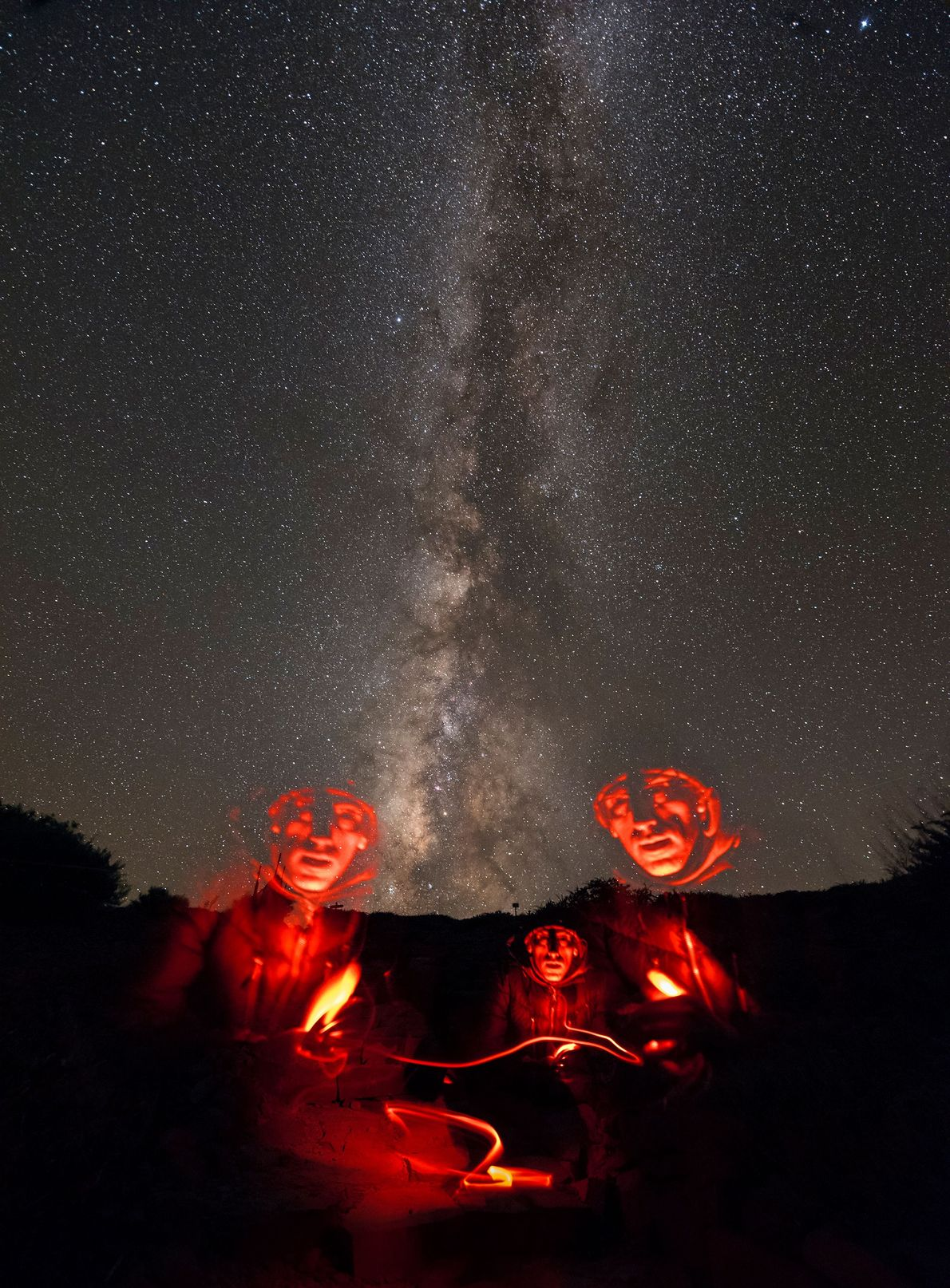 A photographer takes a self-portrait under the Milky Way, using a long exposure to capture his ...