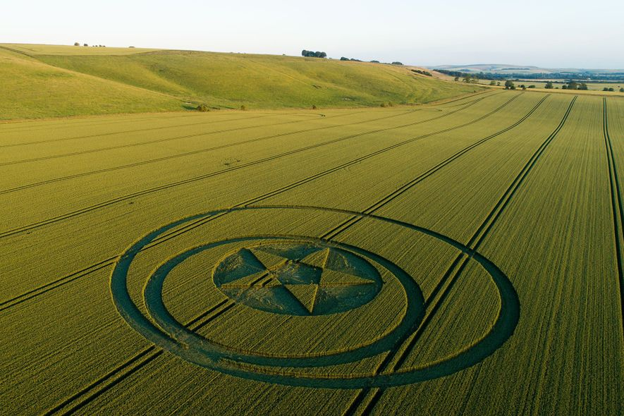 A crop circle near Hackpen Hill, Wiltshire, slices through a farm with surgical precision.