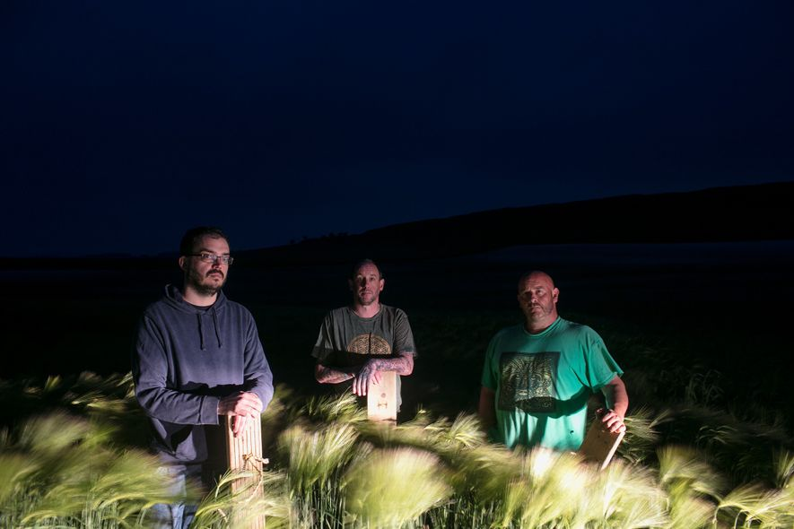 A team self-confessed crop circle artists pose for a portrait in a field outside Dorchester, England. ...