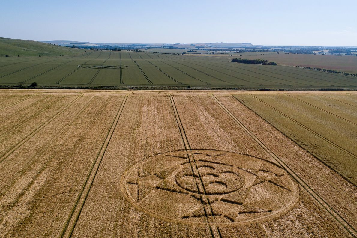 An intricate crop circle decorates a field in the English countryside.