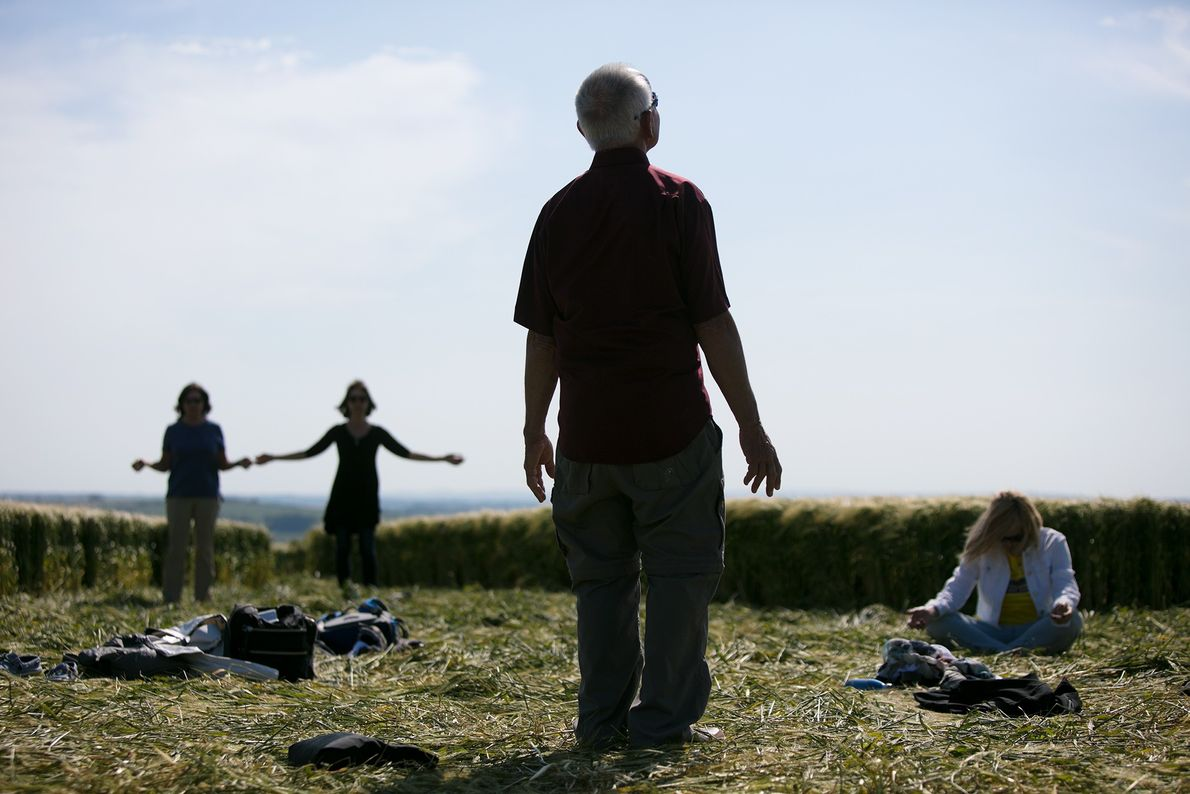 A group of Americans on a sacred tour to Glastonbury perform a ritual in the centre ...