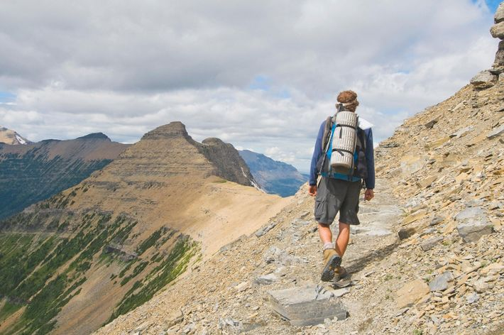 A backpacker hikes along the Continental Divide Trail in Glacier National Park.