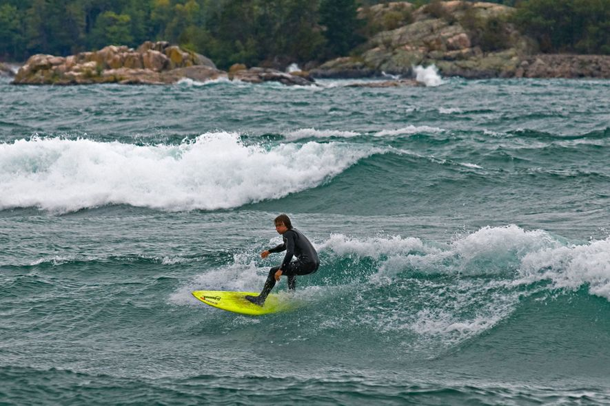 A surfer rides Lake Superior waves just outside Marquette, Michigan.