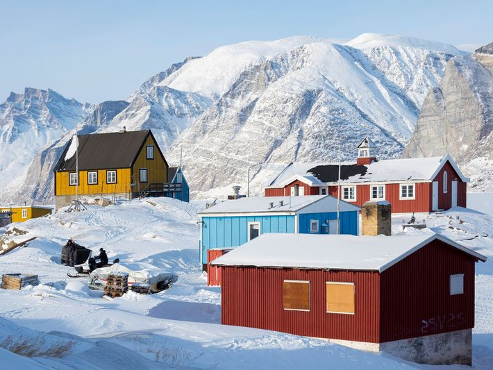 The colourful houses of the fishing village of Saatut in Greenland stand out beautifully against the ...